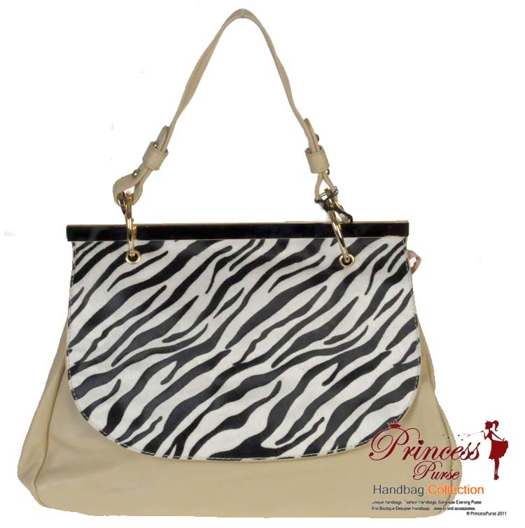 Designer Inspired Leatherette Handbag w/ Zebra Print and Gold Tone Trim.